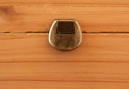 Old metal lock over a wooden background Stock Photo - 10413412