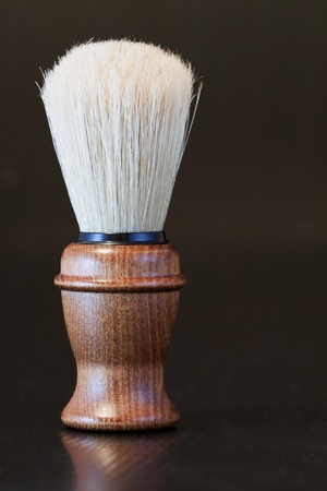 black barber: Elegant old brush with wooden handle for shaving