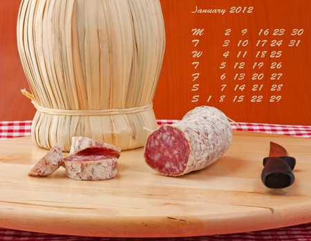 Page of calendar of 2012 with Italian cuisine: sausage and wine photo
