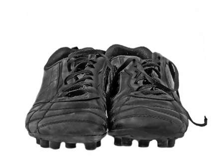 soccer shoes: Close up of black used soccer shoes over white Stock Photo