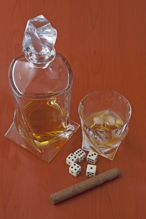 Whisky, cigar, dice and cards over wooden background photo