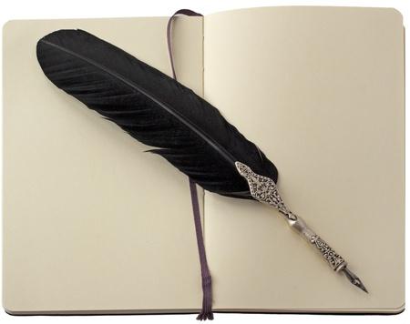 Old elegant black pen over a notebook