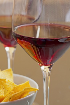 Closeup of glasses of wine and appetizers on a table Stock Photo
