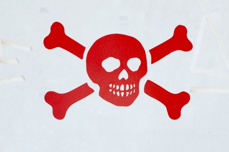 Red death symbol over a gray cartel