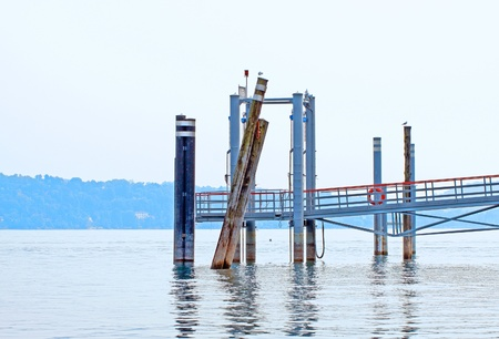 Pier for ships in between a lake photo