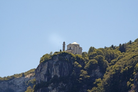 Big white church on the cliff of a mountain photo