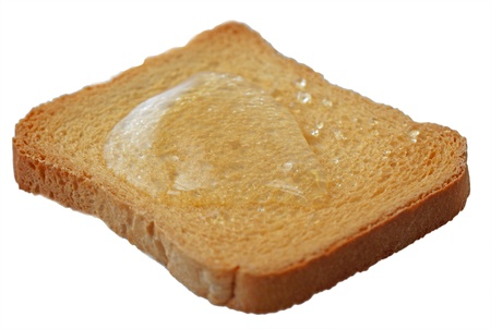 Rusk with honey, isolated over white, selective focus photo