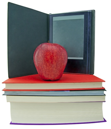 An apple on top of a books pile, with ebook reader on the back photo