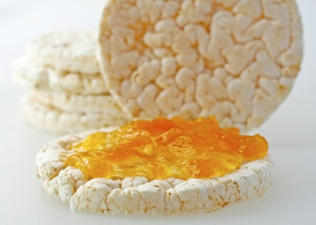 Close up of rice cakes with orange jam Stock Photo