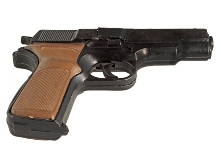 Close up of a black and brown gun over white photo
