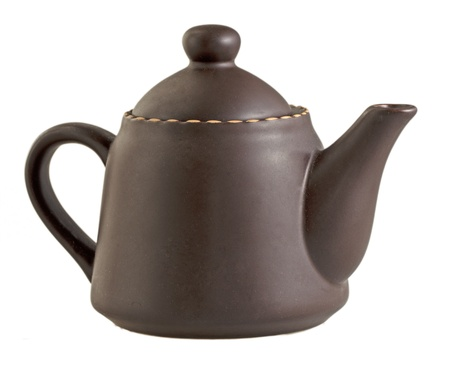Brown teapot isolated over white background photo