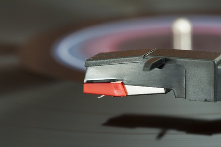 wheeling: Closeup of needle over a wheeling record on a turntable