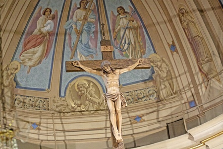 Big crucifix in the apse of a church photo
