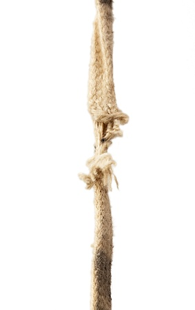 Vertical image of a breaking rope over white background photo