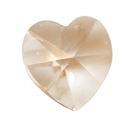 Close up of a crystal heart over white photo