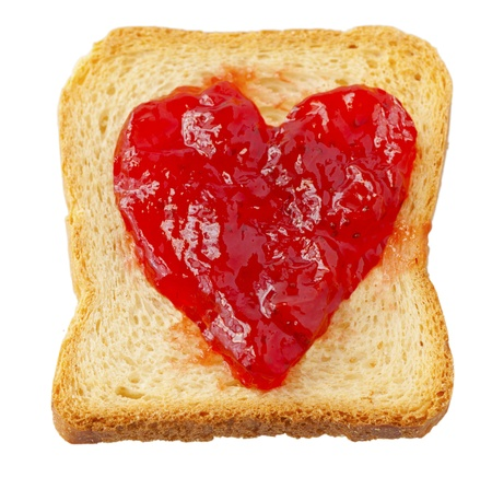 Rusk with strawberry jam in shape of heart photo