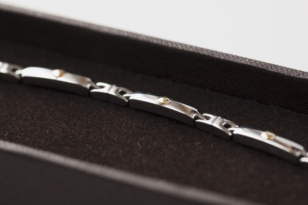 Precious bracelet inside a black box photo