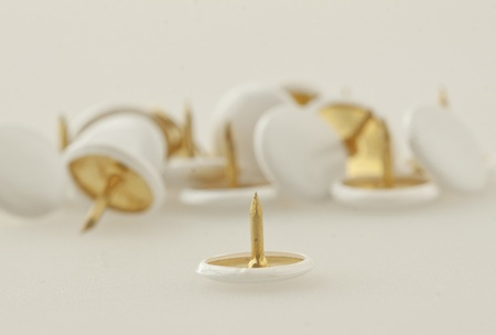 Closeup on one white pushpin with other pushpins on the background Stock Photo - 12114181