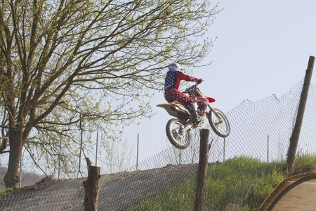 CASALE MONFERRATO, ITALY - APRIL 2: Motocross Race: rider jumping off a cliff. April 2, 2011