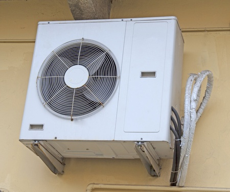 Externe engine of an air conditioner pending from wall photo