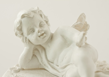 Close up of a little statue of an angel photo