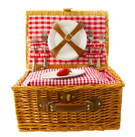 fruits basket: Wooden basket for picnic with plates and a strawberry isolated over white