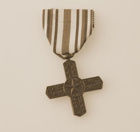 Sepia image of an Italian decoration: War Cross of World War I photo