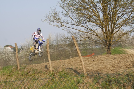 CASALE MONFERRATO, ITALY - APRIL 2: Motocross Race 'Skube Trophy': rider jumping off a cliff. April 2, 2011