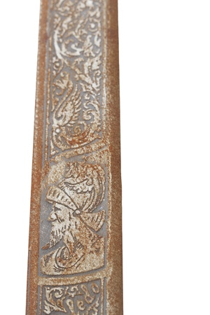 Decoration of a Blade of an old and rusty sword, on white Stock Photo
