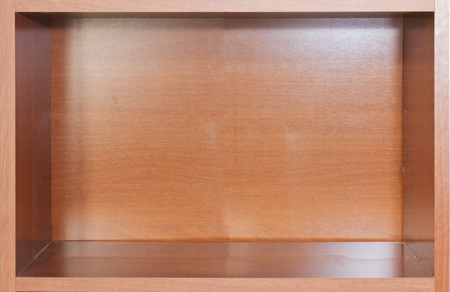 An empty wooden bookshelf, ideal for background photo