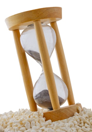 Wooden Hourglass with black sand over white sand