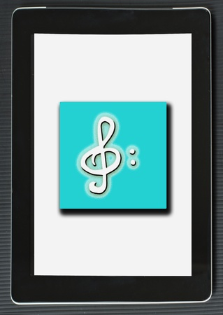 Treble clef over lite blue square, on the screen of a tablet Stock Photo - 13658255