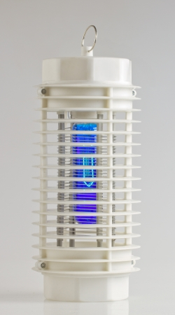 Entire view of a white mosquito lamp with blue light