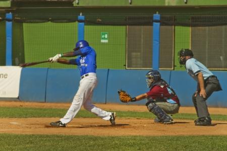 NOVARA, ITALY - JULY 7: Baseball game Novara (blue)-Bologna (purple) 1-17, Italian Serie A. Novara shortstop Carlos Boza homers in third inning. July 7, 2012