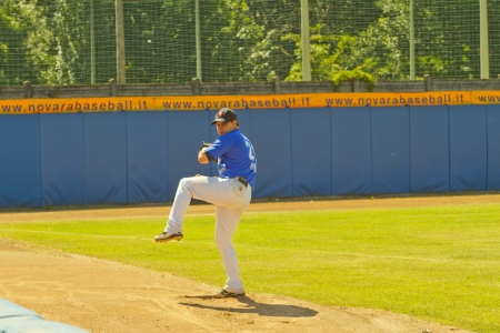 NOVARA, ITALY - JULY 7: Baseball game Novara (blue)-Bologna (purple) 1-17, Italian Serie A. Novara pitcher Sergio Tardivo warms up in the bullpen. July 7, 2012