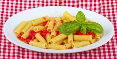 maccheroni: Typical Italian pasta maccheroni with raw tomatoes