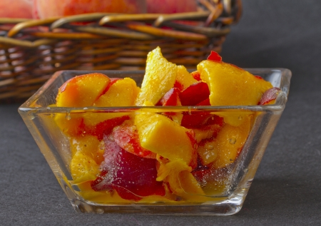 Macedonia of peaches and sugar in a glass cup Stock Photo