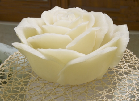 A big white candle in shape of a rose photo