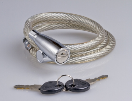 A gray chain for bicycle, with keys, over gray background photo