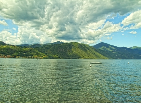 View of a lake with big clouds