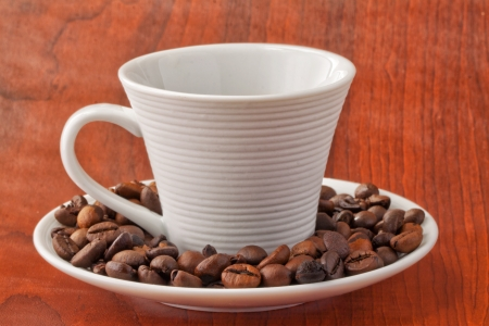 Close up of a cup of coffee with coffee beans photo