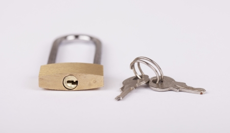 Golden lock and keys over white background Stock Photo - 16650699