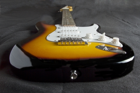 Entire view of electric guitar over black background Stock Photo - 16878707