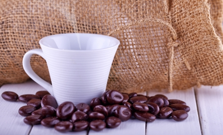 Close up of a cup of coffee with coffee beans Stock Photo - 16878710