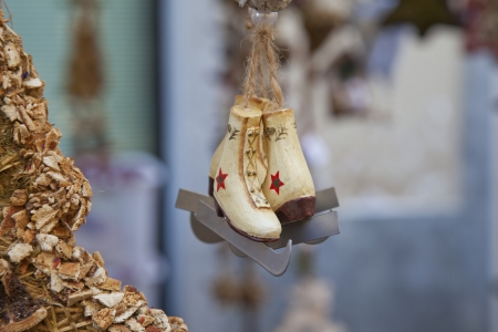 Decoration of little snow shoes pending from a tree Stock Photo - 16878713