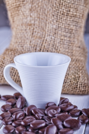 Close up of a cup of coffee with coffee beans Stock Photo - 16878709