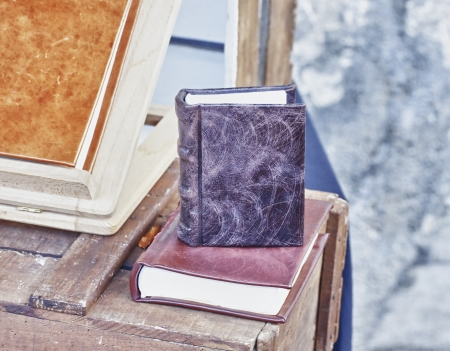 Old little book with leather cover over another book Stock Photo - 16985345