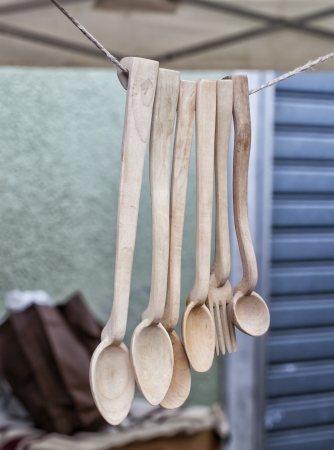 Wooden spoons and a fork pending from a wire Stock Photo - 16985342