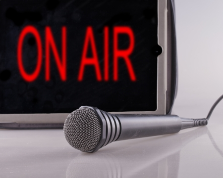 Microphone with a tablet with the words  on air Stock Photo - 17038434