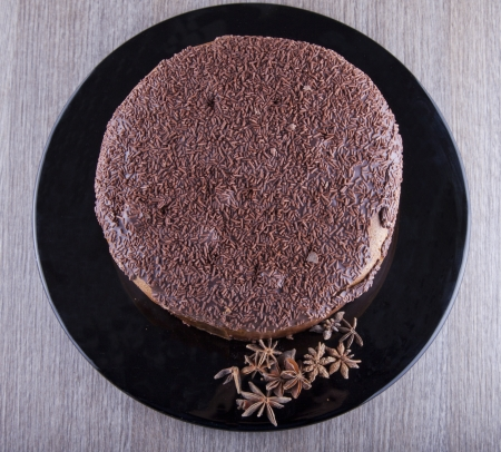 Chocolate cake seen from above over black plate Stock Photo - 17090570